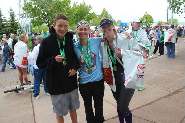 Jessica, right, with family at the finish line.