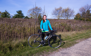 Health and Wellness Management student with her bicycle