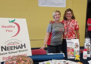 Jessica Lehman and Mary Shandonay smiling at a wellness booth