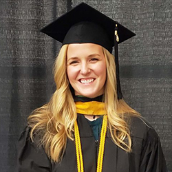 Headshot of Kristie Skul wearing her graduate cap and gown.