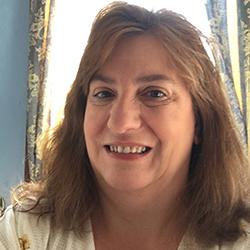 Headshot photo of Theresa Crawford smiling.